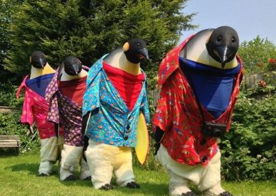 Penguins Abroad – Walkabout Act  UK