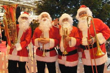 hire the brass santas
