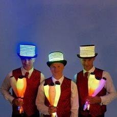 Booking agent for glowing juggling troupe